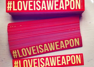 Love is a Weapon Sticker Hashtag